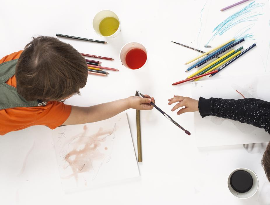 Children passing pencils