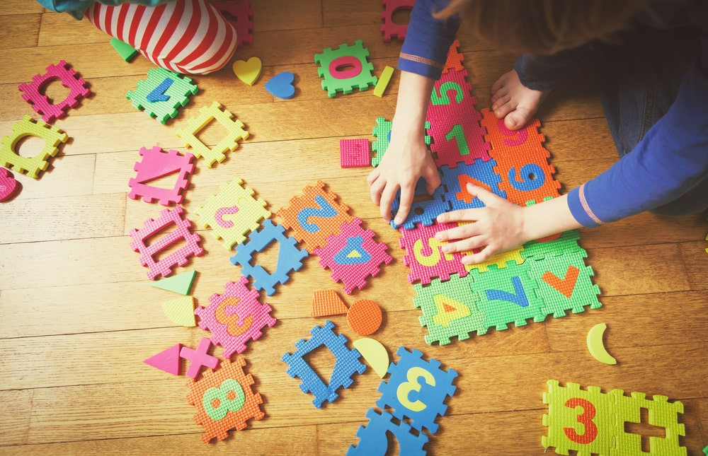 Kids playing puzzle education concept
